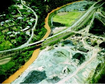 Big Wheeling Creek in Lansing, Ohio is shown here in 1972, when it was polluted with sulfuric acid, iron pyrites, and other mine runoff. Reclamation efforts can slowly return polluted sites to a more acceptable state.