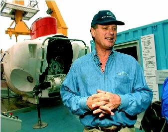 Robert Ballard stands in front of the DSV Turtle research submarine (short for Diving Support Vehicle), on display in 1999 at the Mystic Aquarium in Mystic, Connecticut. The Turtle, retired in 1991 by the U.S. Navy, was a sister submarine to the DSV Alvin, which provided the first glimpses of the Titanic wreck site in 1985.