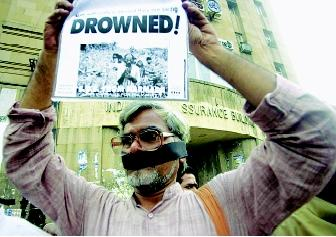 Conflicts can arise over water management when interests of various stakeholder and user groups differ. Dam-building is one controversial water-related issue that can draw the ire of local, regional, and national environmental groups, as represented here by a symbolically gagged protestor in Bombay, India.