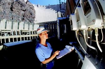 Water resources engineering encompasses many specialties. Here an engineer reads gages at the Hoover Dam.