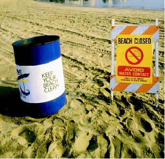 This ironic juxtaposition of two signs on a public beach reveals the complex task that society faces in protecting both land and water quality. The U.S. Environmental Protection Agency has established National Beach Guidance and Performance Criteria for Recreational Waters designed to ensure the public's health and improve environmental protection for beaches. The Clean Water Act restricts discharges of pollutants into the nation's waterways.