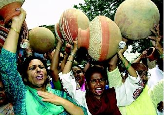Conflicts over water often emerge when different groups of people have different goals. Here, New Delhi women carrying traditional water pots protest in May 2000 over an ongoing shortage of water and electricity in the Indian capital and surrounding areas.