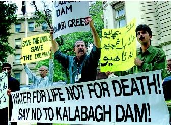 Protestors in front of the Pakistan embassy in Washington, D.C. in 2000 wave placards against the proposed Kalabagh Dam on the Indus River. Their concerns included the displacement of people, environmental impacts, and the ultimate distribution of water. The Pakistani government was compelled to cancel its construction plans because of these stakeholder conflicts.