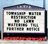 A sign warns residents that they may no longer water their lawns because of drought conditions. Lack of rain in conjunction with high temperatures can lead communities and even states to enact water-use restrictions in an attempt to control water demand.