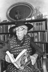 Marjory Stoneman Douglas, until her death at 108, remained devoted to environmental activism to protect and restore the Everglades. Here she poses at age 96 with her best-known book.