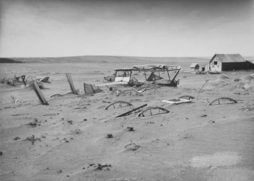 During the Dust Bowl of the 1930s, nearly two-thirds of the U.S. land area experienced severe to extreme drought conditions. This ruined farm is buried under layers of dirt and sand blown across the landscape.