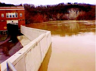 The construction of a floodwall in Frankfort, Kentucky was barely finished when it protected South Frankfort during a major flood in 1997. The floodwall runs through part of the Second Street Elementary School (shown here).