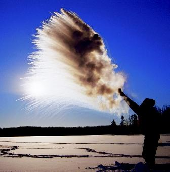 Boiling hot water thrown from a cup into very cold air will almost instantly freeze in midair and create a shower of ice crystals, as demonstrated here in northern Minnesota. See the sidebar on page 103 for an explanation.