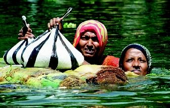 Changes in rain events, such as monsoon rains, can have either beneficial or detrimental effects: namely, decreased rainfall can cause water shortages, and increased rainfall can aggravate flooding. These women in western Bangladesh float food packs on a raft during monsoon flooding in 2000 that affected more than 2.5 million people. The potential impact of global warming on monsoon circulation is unknown.