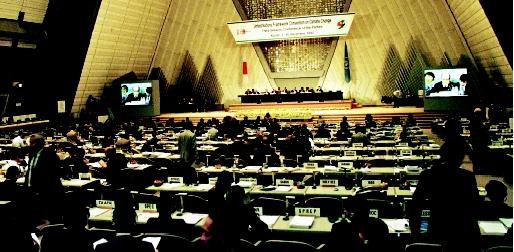 Japanese environment minister Hiroshi Oki is seen on two screens as he addresses the final plenary session of the United Nations Global Warming Conference in Kyoto, Japan in December 1997. A treaty aimed at heading off a potentially catastrophic warming of Earth was formally adopted after 11 days of debate. As of 2002, the protocol still awaited international consensus.