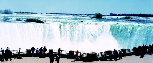 Niagara Falls is located on the international line between the cities of Niagara Falls, New York, and Niagara Falls, Ontario. This world-famous tourist destination, like other Great Lakes attractions, bolsters the local and regional economies of both countries.
