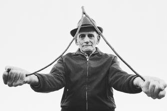 "Despite the lack of scientific evidence, the ancient practice of ""water witching"" (also called dowsing) remains popular. This dowser claims he can locate groundwater supplies and even predict their depth by using only a forked branch."