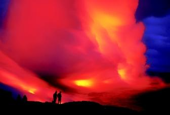Clouds of steam reflect the red glow of lava as it flows from Hawaii's erupting Kilauea Crater into the Pacific Ocean. In this one instant, visitors witness water in various forms: vapor (steam), ocean (salt water), and perhaps ancient water molecules (originally from precipitation) in the magma (molten rock) derived from Earth's interior. In one portion of the hydrologic cycle, the water vapor is carried over the ocean and land, eventually returning to Earth as precipitation.