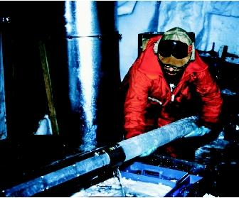 An ice core sample is produced by drilling a circular pipe-like device into thick ice and then pulling out the cylindrical piece. Here an Antarctic ice core from 1.2 kilometers (about 0.75 miles) below the surface is removed from the drill. The age of the ice is at least 130,000 years.