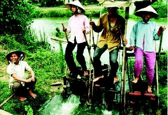 Various types of water-moving devices have been used since ancient times. A typical human-powered device, demonstrated here in a Vietnamese rice paddy, is still used today in Asian and some African countries to irrigate small plots.