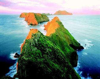 The summer-vegetated Anacapa Island and other islands of Channel Islands National Park, California glow orange at sunset. During the last Ice Age, the northern islands were part of one vast island. When the continental ice sheets melted, sea level rose and the islands became separated by water.