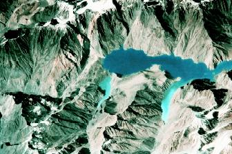 The 61-kilometer-long Lake Sarez was created in 1911 in the Pamir mountains of Tajikistan when a strong earthquake triggered a massive landslide that formed a huge natural dam. As of 2002, central Asian governments, the World Bank, the United Nations, and the United States Agency for International Development were considering gradually lowering the lake level to prevent catastrophic floods downslope and downstream if seismic activity were to cause a breach in the natural dam.
