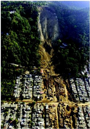 As a 7.6-magnitude earthquake rocked El Salvador in January 2001, this hillside above a suburban neighborhood gave way. The landslide buried hundreds of homes and accounted for over half of the nearly 700 earthquake victims.