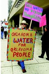 The governance of state waters sometimes can be a source of debate. Here a protestor opposes the proposed sale of Oklahoma water to Texas via a possible state-tribal compact.