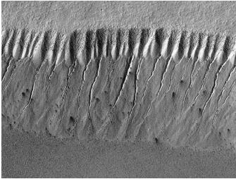 These gully landforms near the south polar region of Mars show evidence of geologically recent seepage and runoff of liquid water. Today, however, water on Mars appears to exist mainly as subsurface ice.