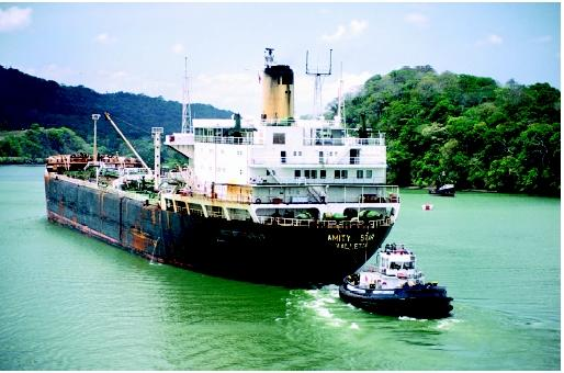 Tanker carriers are a major mode of export for petroleum resources. This tanker is assisted by a tugboat in the Panama Canal.