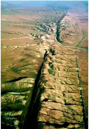 The San Andreas fault is the border between two tectonic plates—the North American Plate and Pacific Plate. Los Angeles is located on the Pacific Plate, and San Francisco is on the North American Plate. In a few million years, the two geographic areas will be right next to each other because the western side of the fault (the Pacific Plate) is moving northward with respect to the rest of the state. The fault is moving at about 2 centimeters (just under an inch) per year.