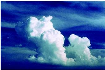 The formation of clouds and precipitation is a function of latitude, topography, and the presence of warm or cold oceans or large lakes, among other factors. This cumulus cloud is building into a cumulonimbus, which can bring heavy thunderstorms and even tornadoes.