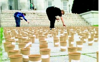 "Special-interest groups articulate the concerns of like-minded stakeholders to decisionmakers. Here, volunteers for the Vermont Public Interest Research Group fill 10,000 ""cups of life"" with water to represent each person who signed the group's Water for Life petition in 2000. The petition encouraged state lawmakers to pass clean water legislation."
