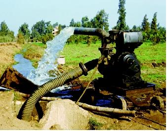 Although most modern pumps are electrically powered, this pump in an Egyptian farm field is driven by an engine. The pump is mounted on wheels so that it can be moved from one location to another along irrigation channels.
