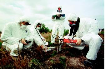 Radiologists measure soil radioactivity levels near Ukraine's Chernobyl Nuclear Plant, where a nuclear reactor exploded in 1986, releasing 100 times the radiation released by the atomic bombs dropped on Hiroshima and Nagasaki during World War II. Approximately 125,000 to 146,000 square kilometers (48,000 to 56,000 square miles) were affected by the contamination, including the region's water resources.