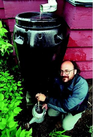 A rain barrel is a simple method of collecting rainfall pouring from a downspout. The stored rainfall can then be drawn out and redirected to specific uses.