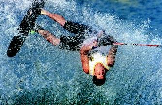 Wakeboarding (a form of water skiing) had humble beginnings in the 1980s, but by 2000 had become the world's fastest-growing water sport. Here a tournament skier executes a flip during the Water Skiing World Championships.