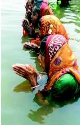 Hindu women pray in the Old Brahmaputra River in central Bangladesh at the start of an annual 2-day religious ceremony. Hindus believe that bathing in the waters of a holy river, such as the Brahmaputra in Bangladesh and the Ganges in India, will purify one's life of past sins.