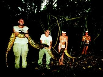 These Matses Indian men hold a thick-bodied, 5.5-meter long (18-foot-long) anaconda that they killed during a hunt. The anaconda is native to the Amazon-Orinoco Basin in South America.