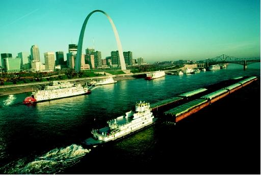 Commercial navigation (represented by the barge, foreground) and other river-based transportation (represented by the paddlewheelers, background) are examples of public water rights. Navigation—in this case along the Mississippi River near the Gateway Arch in St. Louis, Missouri—is a particularly dominant right held by government for the public benefit.