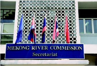 International flags fly outside the Mekong River Basin Commission, whose headquarters moved from Bangkok, Thailand to Phnom Penh, Cambodia in 1998. This commission consists of representatives from the four nations of the Lower Mekong River Basin—Cambodia, Laos, Thailand, and Vietnam.