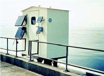A tide gage installation in this gagehouse monitors tidal fluctuations. The solar panels provide energy for operating the automated recording equipment. Traditional analog-to-digital recorders driven by a float within a stilling well (a vertical pipe that quiets the water surface in the vicinity of the water-level sensor) gradually are being replaced by state-of-the-art designs that employ new technologies and microprocessor-based data collection and recording subsystems.