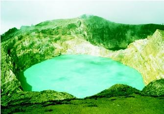 "A combination of dissolved and precipitated minerals leads to the turquoise-green color of this crater lake on Kelimutu Volcano, a popular tourist location on Flores Island, Indonesia. The water's high temperature (approximately 37°C [about 100°F]) and extreme acidity (pH less than 1) helps dissolve Earth minerals. The color of this lake and its two nearby ""sister"" lakes (also located on the summit area) is in constant flux, perhaps owing to changes in magma activity."