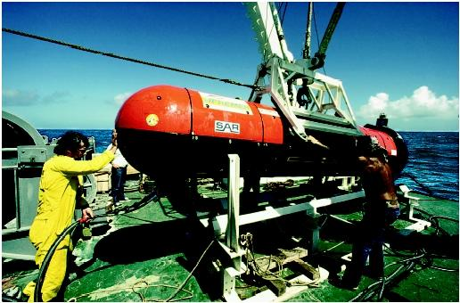 The crew of Le Suroit prepare to launch deep-sea sonar in 1985 during a search for the wreck of the Titanic. Sonar (sound navigation and ranging) uses sound to locate and identify targets, whether shipwrecks, submarines, or schools of fish.