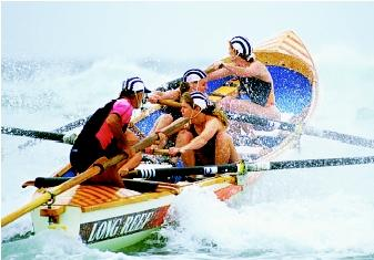 In addition to preventing injuries and deaths, ocean lifeguards may enter surf lifesaving competitions, a surf sport that helps participants develop and demonstrate their lifesaving skills. These athletes compete in the women's surfboat race at the 1995 New South Wales Surf Lifesaving Championships along the Australian Gold Coast.