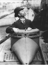 John Holland is shown in this 1898 photograph, sitting in the turret of an early submarine. His advancements eventually led to the world's first submarine fleet.