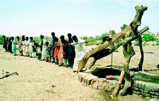 Access to safe and reliable local water supplies is a major challenge in many communities in developing countries. Without the benefit of piped-in supplies, many people must devote part of their day to securing water for their daily needs. In this photograph, Pakistani villagers pull drinking water from a 122-meter (400-foot) well.