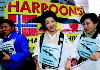 The concept of sustainable development applies not only to water itself, but also to the living resources it supports. Shown here are Japanese supporters of commercial whaling standing in front of an anti-whaling banner at an annual meeting of the International Whaling Commission.
