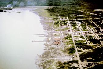 In 1964, an 8.4-magnitude earthquake in Alaska's Prince William Sound triggered a large landslide, which in turn caused a local tsunami. The extent of the inundation in Valdez, Alaska is visible in this photograph. After the tsunami, which killed thirty people, a large portion of the town was relocated to safer ground.