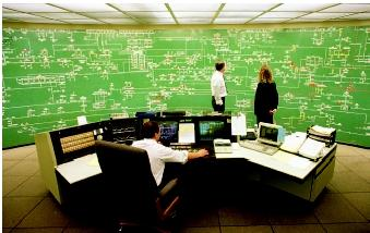 A utility control room is the central point for monitoring utility operations and coordinating supply and demand within the community. The map-like board gives operators and managers an instant picture of the system and its components.