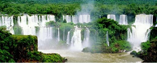 Situated on the border of Brazil, Argentina, and Paraguay, Iguazu Falls consists of 275 cascades spread across nearly 3.3 kilometers (2 miles). With an average (nonflood) discharge of 1,700 cubic meters per second (60,000 cubic feet per second), these falls are among the most powerful in the world.