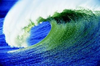 The classic curl of a breaking wave is associated worldwide with surfing. As a wave approaches shore, friction slows the bottom of the wave while allowing the top to continue moving, which causes the top to lean forward in this manner.