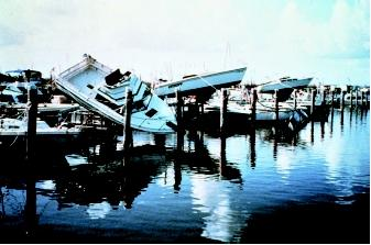Large waves generated by hurricanes and other natural events can wreak havoc along the coast and cause flooding far from shore. Despite the sometimes spectacular damage caused along the coast, inland flooding causes approximately half of the hurricane-related deaths in the United States. These boats in a marina were tossed about by Hurricane Andrew in 1992, whose storm surge inundated areas from the northwestern Bahamas, through the southern Florida peninsula, up to the coast of Louisiana.